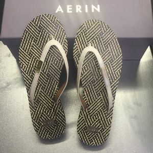 Aerin New Patent flip flop with gold details.